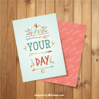 Decorative greeting card with vegetation and feathers