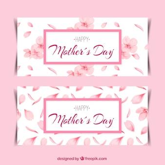 ピンクの花と花びらで装飾母の日バナー