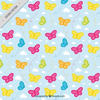 Decorative pattern of butterflies and clouds