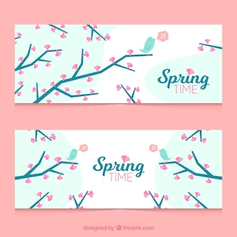 Decorative spring banners with pink flowers and cute birds