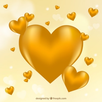 Defocused background of golden hearts