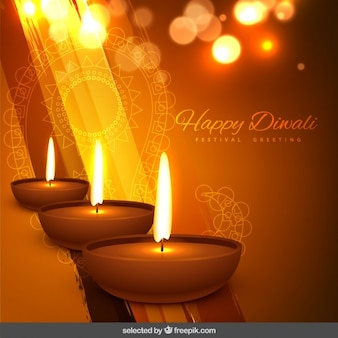 Diwali festival greeting with three candles