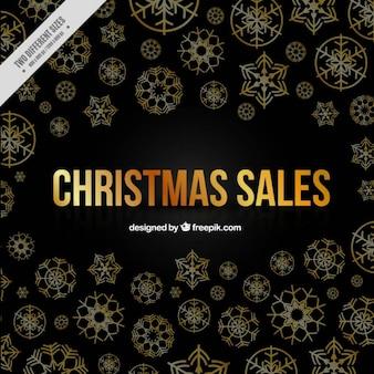 Elegant sale background of golden snowflakes