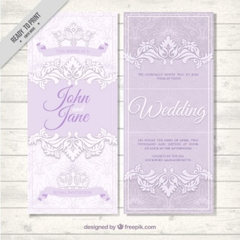 Elegant wedding invitation with hand drawn ornamental leaves