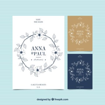 Elegant wedding invitations with floral wreath