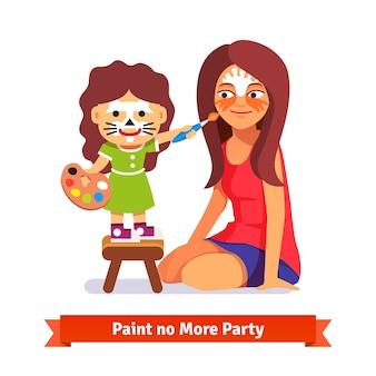 フェイスペインティングパーティー。女の子と彼女の先生