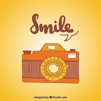 Fantastic background with vintage camera in hand-drawn style