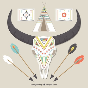 Fantastic skull next to other elements in boho style