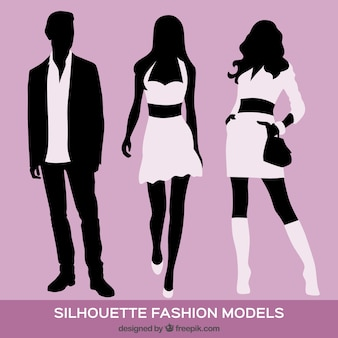 Fashion models silhouettes on violet background