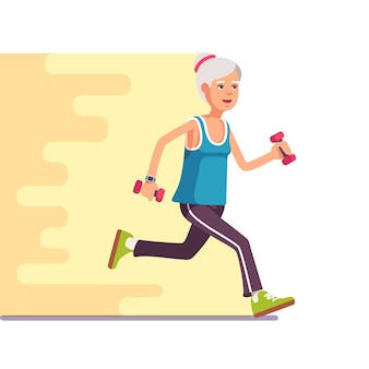 Fit elderly woman jogging with dumbbells