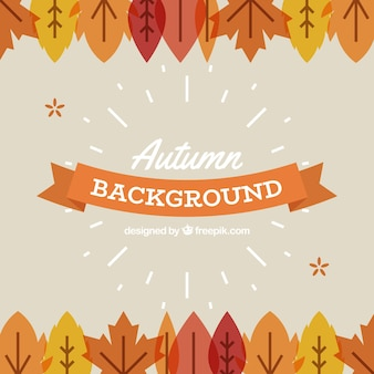 Flat autumnal background with leaves and ribbon