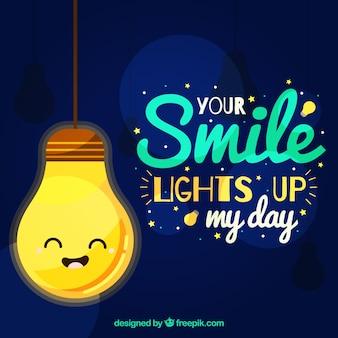 メッセージと笑い電球と平らな背景