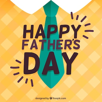 Flat background with necktie and checkered pullover for father's day