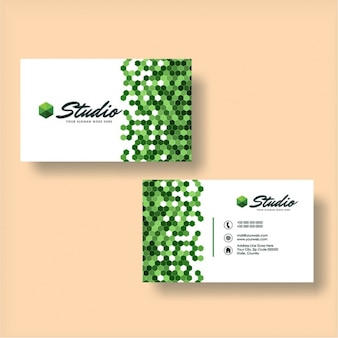 Flat business card with hexagons in green tones