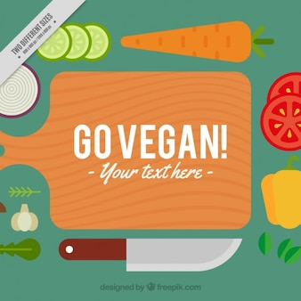 Flat vegan food and cutboard in a top view background