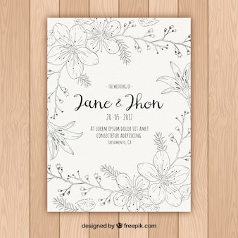 Floral wedding invitation in hand-drawn style