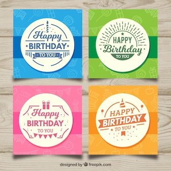 Four birthday cards in different colors