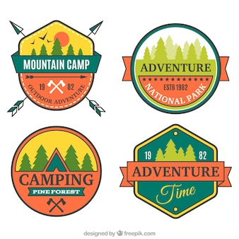 Four colorful badges for camping