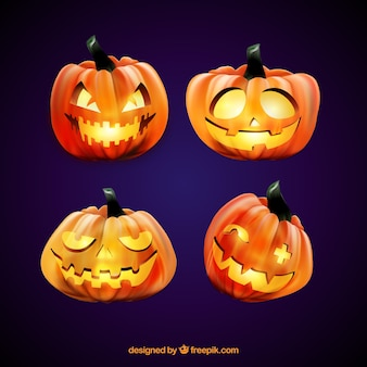 Four lighted halloween pumpkins