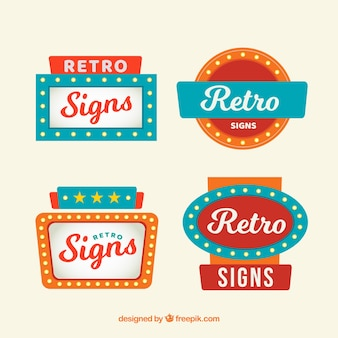Four vintage signs with lights