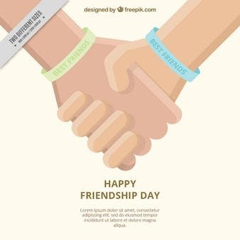 Friendship day background with joined hands in flat design