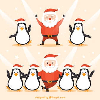 Funny santa claus and penguins dancing
