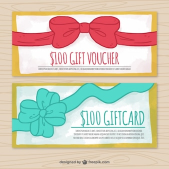 Gift vouchers with decorative ribbons and golden frames