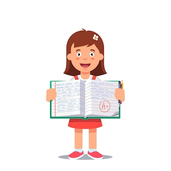 Girl and open school workbook with handwriting