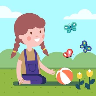 Девочка играет в мяч на лугу с цветами