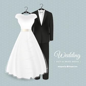 Glamorous wedding suit and bride dress