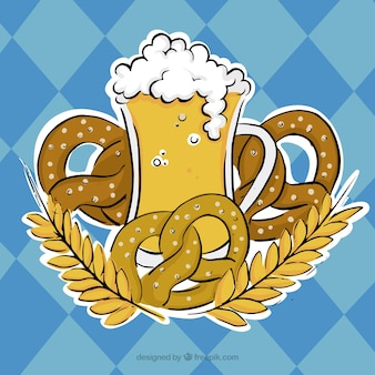 Glass of beer surrounded by pretzels