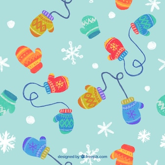 Gloves on a snowflakes background pattern