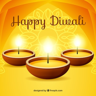 Golden background of happy diwali with candles