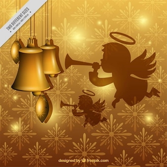 Golden background of snowflakes with angel and bells