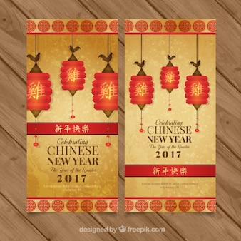 Golden banners for chinese new year with decorative lanterns