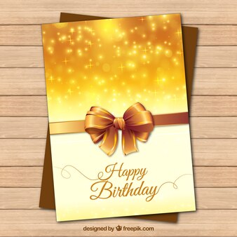 Golden birthday card with a realistic bow