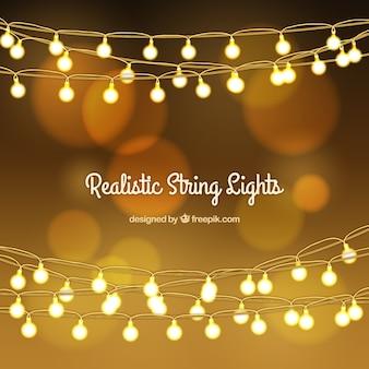 Золотой боке фон с струнные светильники