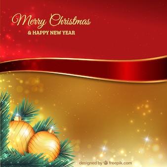 リボンの背景とゴールデンクリスマスボール