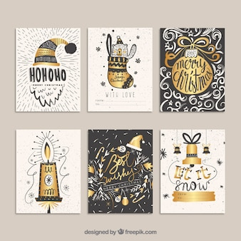 Golden christmas cards in hand drawn style