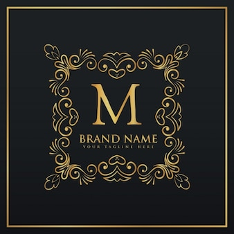 Golden ornamental logo with the letter m