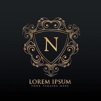 Golden ornamental logo with the letter n