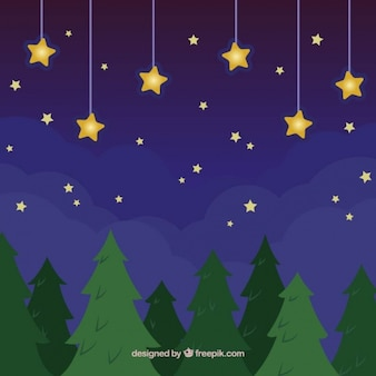 Golden stars and trees at night