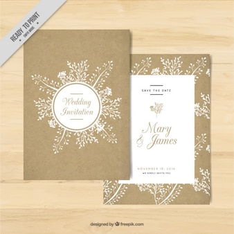 Golden wedding invitation with floral elements