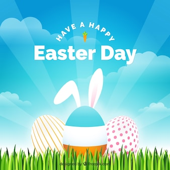 Grass background with easter eggs and bunny ears