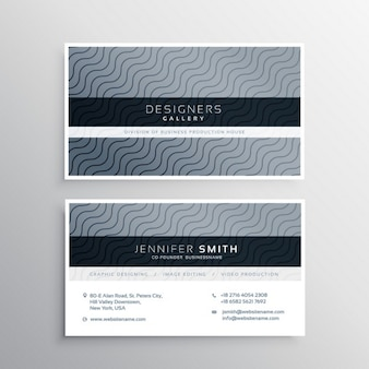 Gray business card with elegant ornaments