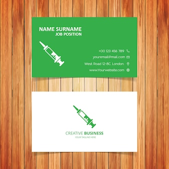 Green and white hospital business card