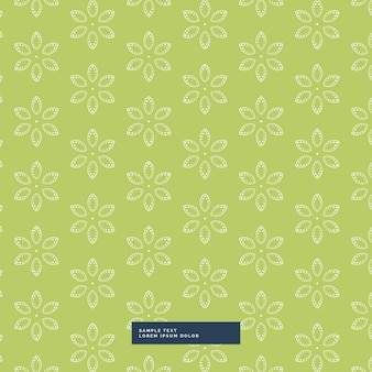 Green background with a floral pattern