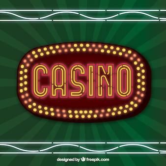 照明されたサインカジノと緑色の背景