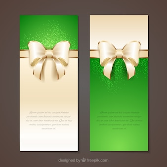 Green banners with ribbons