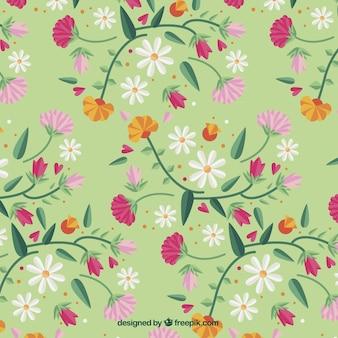 Green decorative pattern of hand drawn flowers